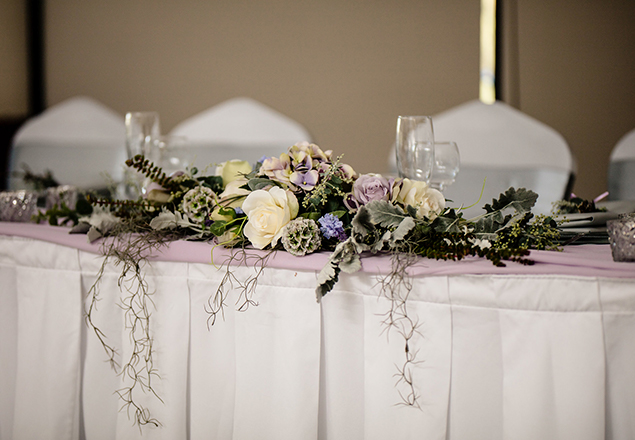 Long and Low floral display on bridal table