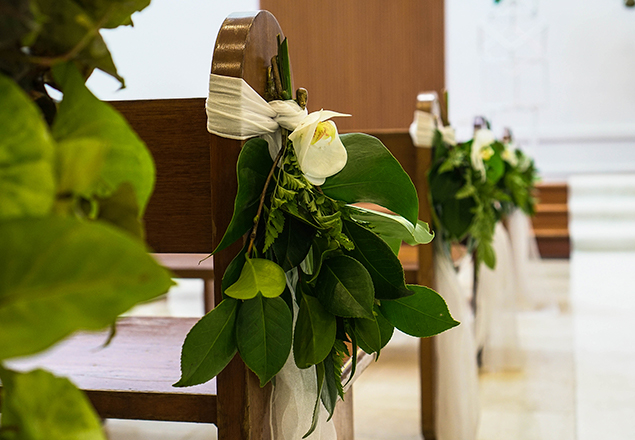 Greenery attached to pew ends